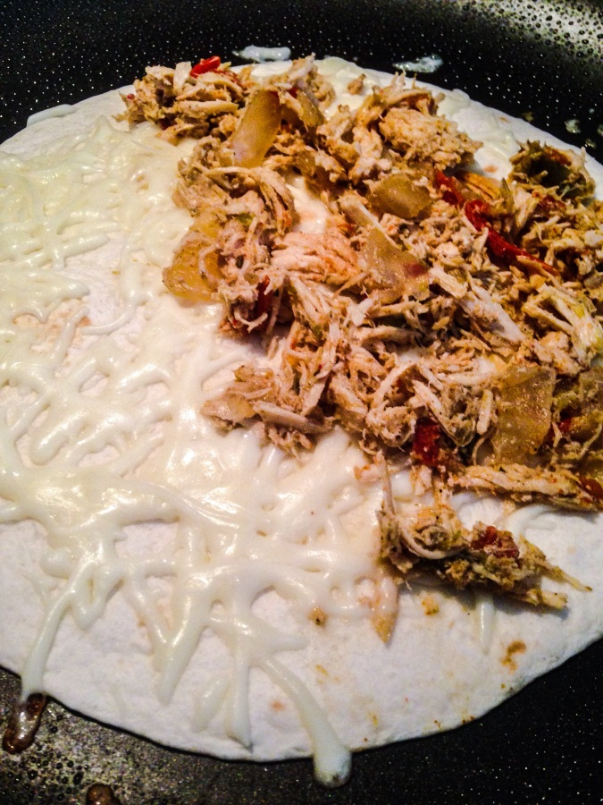 heat quesadilla in a skillet with cooking spray until crispy THEN fold over