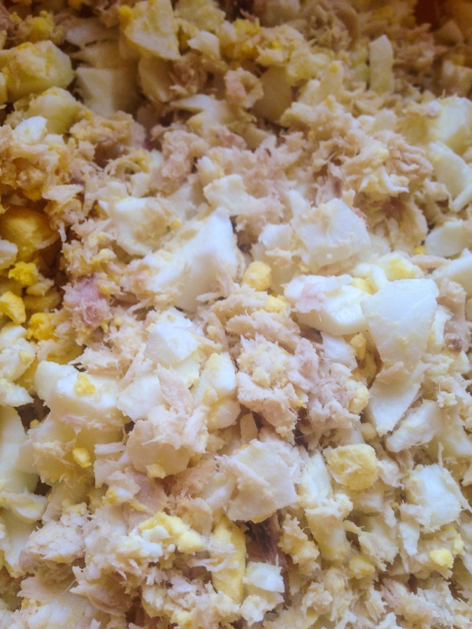 Combine tuna, pickles, onion, egg, and seasoning in a large bowl