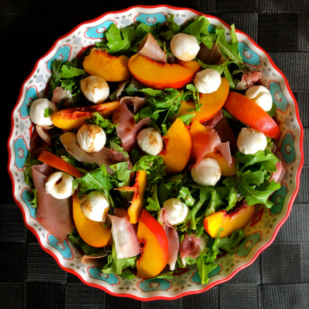 Maybe every salad was intended to have peaches and prosciutto...